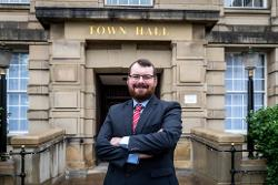 Councillor Eamonn O'Brien in front of the Town Hall