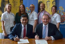 Rishi pictured signing the Memorandum of Understanding with Professor George Holmes, president and vice-chancellor of the University of Bolton, and University of Bolton students/graduates.