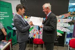 David with Andy Burnham signing the pledge